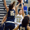 Monarch's Raegen Rohn goes to the basket against Legacy's Jenna Fenton during Friday's game at Monarch High.<br /> February 15, 2013<br /> staff photo/ David R. Jennings