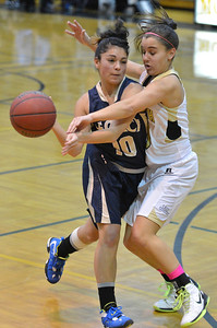 Legacy's Emiley Lopez collides against Monarch's Ellie Dietz during Friday's game at Monarch High. February 15, 2013 staff photo/ David R. Jennings