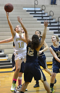 Monarch's Ellie Dietz rebound the ball from Legacy's Mackenzie Neely during Friday's game at Monarch High. February 15, 2013 staff photo/ David R. Jennings