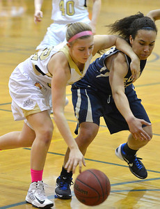 Monarch's Lauren Mendicino fights for the ball with Legacy's  Mackenzie Neely during Friday's game at Monarch High. February 15, 2013 staff photo/ David R. Jennings