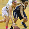 Monarch's Lauren Mendicino fights for the ball with Legacy's  Mackenzie Neely during Friday's game at Monarch High.<br /> February 15, 2013<br /> staff photo/ David R. Jennings