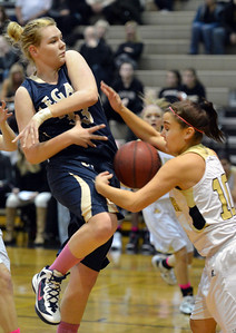 Legacy's Courtney Smith has the ball stripped from her by Monarch's Ellie Dietz during Friday's game at Monarch High. February 15, 2013 staff photo/ David R. Jennings