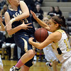 Legacy's Courtney Smith has the ball stripped from her by Monarch's Ellie Dietz during Friday's game at Monarch High.<br /> February 15, 2013<br /> staff photo/ David R. Jennings