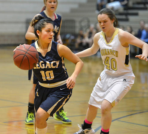 Legacy's Emiley Lopez moves around Monarch's Jordan Eisler during Friday's game at Monarch High.<br /> February 15, 2013<br /> staff photo/ David R. Jennings