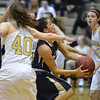 Legacy's Emiley Lopez goes to the basket between Monarch's Jordan Eisler and Ellie Dietz during Friday's game at Monarch High.<br /> February 15, 2013<br /> staff photo/ David R. Jennings
