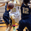 Monarch's Ellie Dietz goes to the basket against Legacy during Friday's game at Monarch High.<br /> February 15, 2013<br /> staff photo/ David R. Jennings