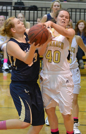 Legacy's Caitlyn Smith goes to the basket against Monarch's Jordan Eisler during Friday's game at Monarch High.<br /> February 15, 2013<br /> staff photo/ David R. Jennings
