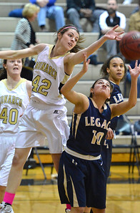 Monarch's Kelly O'Flannigan knocks the ball away from Legacy's Emiley Lopez during Friday's game at Monarch High. February 15, 2013 staff photo/ David R. Jennings