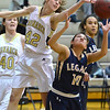 Monarch's Kelly O'Flannigan knocks the ball away from Legacy's Emiley Lopez during Friday's game at Monarch High.<br /> February 15, 2013<br /> staff photo/ David R. Jennings