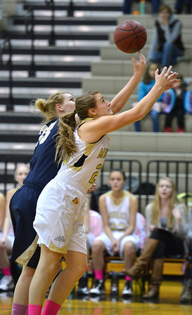 Monarch's Bridget Anthony goes for the ball against Legacy's Courtney Smith during Friday's game at Monarch High.<br /> February 15, 2013<br /> staff photo/ David R. Jennings