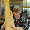 Nancy Brace plays the harp at the Broomfield Senior Center Mother's Day luncheon on Friday.<br /> May 11, 2012 <br /> staff photo/ David R. Jennings