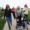 Donna Agee, center, walks with her daughters Jo Easton, left, Andy Barnett and Tye McCarthy after visiting the memorial bench to Doug Agee, husband and father, at Brunner Reservoir after the Broomfield Senior Center Mother's Day luncheon on Friday. <br /> May 11, 2012 <br /> staff photo/ David R. Jennings