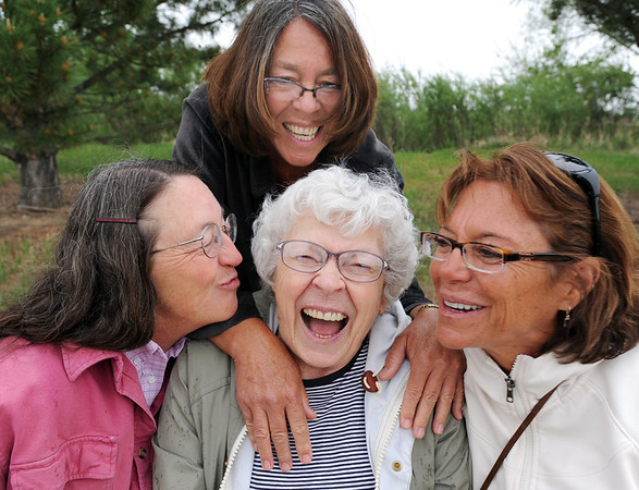 Donna Agee, center, with her daughters Andy Barnett, left, Jo Easton, and Tye McCarthy laugh and talk as they sit on the memorial bench to Doug Agee, husband and father, at Brunner Reservoir after the Broomfield Senior Center Mother's Day luncheon on Friday. <br /> May 11, 2012 <br /> staff photo/ David R. Jennings