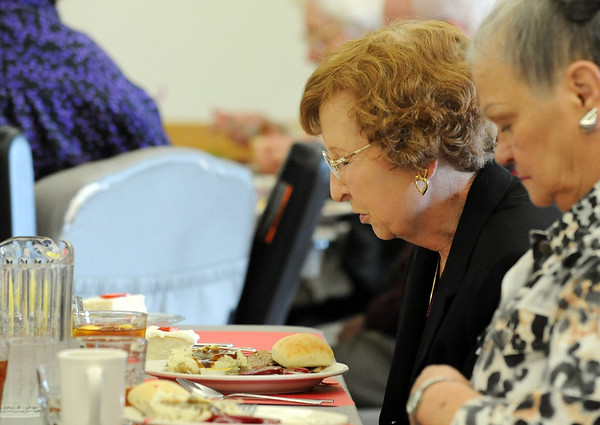 Betty Dalton pauses to pray before eating with her friends at the Broomfield Senior Center Mother's Day luncheon on Friday.<br /> May 11, 2012 <br /> staff photo/ David R. Jennings