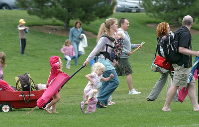 "Families came prepared for the weather and brought chairs, blankets and food to watch the movie ""Kung Fu Panda"" for Movies in the Park Saturday at County Commons Park. July 25, 2009 staff photo/David Jennings"