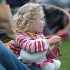 "Maya Walker, 5, eats some popcorn while waiting for the movie ""Kung Fu Panda"" to start during Movies in the Park Saturday at County Commons Park.<br /> July 25, 2009<br /> staff photo/David Jennings"
