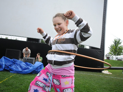 Hannah Lindholm, 10, practices her hula hoop techniques for the hula hoop contest during Movies in the Park Saturday at County Commons Park. July 25, 2009 staff photo/David Jennings