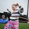 Hannah Lindholm, 10, practices her hula hoop techniques for the hula hoop contest during Movies in the Park Saturday at County Commons Park.<br /> July 25, 2009<br /> staff photo/David Jennings