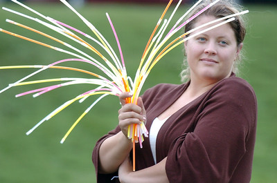 Krista Kliebenstein holds glow sticks being sold to movie goers with the proceeds going to Bal Swan Children's Center during Movies in the Park Saturday at County Commons Park. July 25, 2009 staff photo/David Jennings