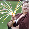 Krista Kliebenstein holds glow sticks being sold to movie goers with the proceeds going to Bal Swan Children's Center during Movies in the Park Saturday at County Commons Park.<br /> July 25, 2009<br /> staff photo/David Jennings
