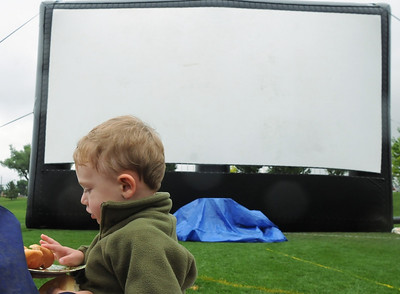 "While waiting for the movie ""Kung Fu Panda"" to start, Charlie George, 2, eats a hotdog during Movies in the Park Saturday at County Commons Park. July 25, 2009 staff photo/David Jennings"