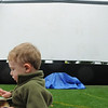 """While waiting for the movie """"Kung Fu Panda"""" to start, Charlie George, 2, eats a hotdog during Movies in the Park Saturday at County Commons Park.<br /> July 25, 2009<br /> staff photo/David Jennings"""