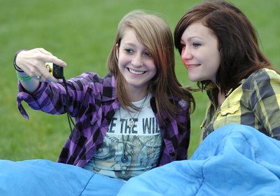 "Lisa Kingsbury, 16, left, takes a picture of herself  and friend Sarah Espinoza, 16, while waiting for the movie ""Kung Fu Panda"" to start at Movies in the Park Saturday at County Commons Park. July 25, 2009 staff photo/David Jennings"