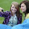 """Lisa Kingsbury, 16, left, takes a picture of herself  and friend Sarah Espinoza, 16, while waiting for the movie """"Kung Fu Panda"""" to start at Movies in the Park Saturday at County Commons Park.<br /> July 25, 2009<br /> staff photo/David Jennings"""