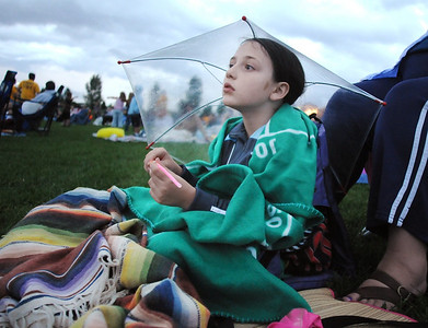 "Terina Patrick,  8, holds her glow stick under her clear umbrella while waiting for the movie ""Kung Fu Panda"" to start for Movies in the Park Saturday at County Commons Park. July 25, 2009 staff photo/David Jennings"