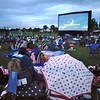 "Movies in the Park attendees take shelter under umbrellas and wrapped in blankets watch the movie ""Kung Fu Panda"" Saturday at County Commons Park.<br /> July 25, 2009<br /> staff photo/David Jennings"