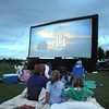 "Movies in the Park attendees wait for  the movie ""Kung Fu Panda"" to start Saturday at County Commons Park.<br /> July 25, 2009<br /> staff photo/David Jennings"