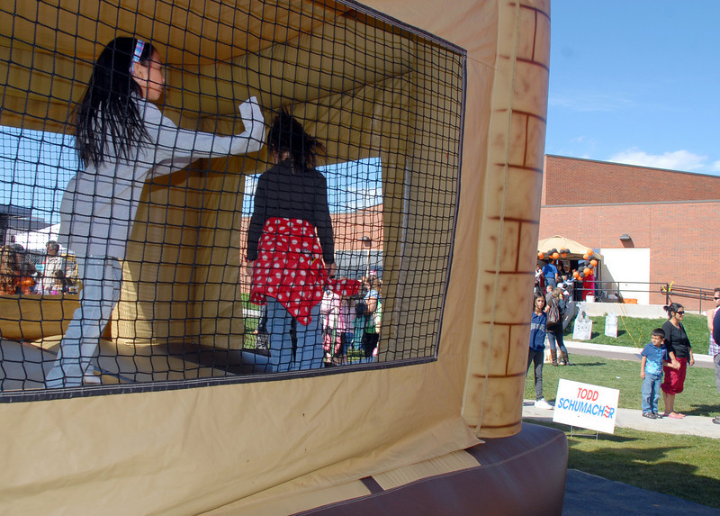 Students bounce in the inflatables during Mtn. View Elementary School's 30th anniversary celebration and fall festival on Saturday.<br /> October 9, 2010<br /> staff photo/David R. Jennings