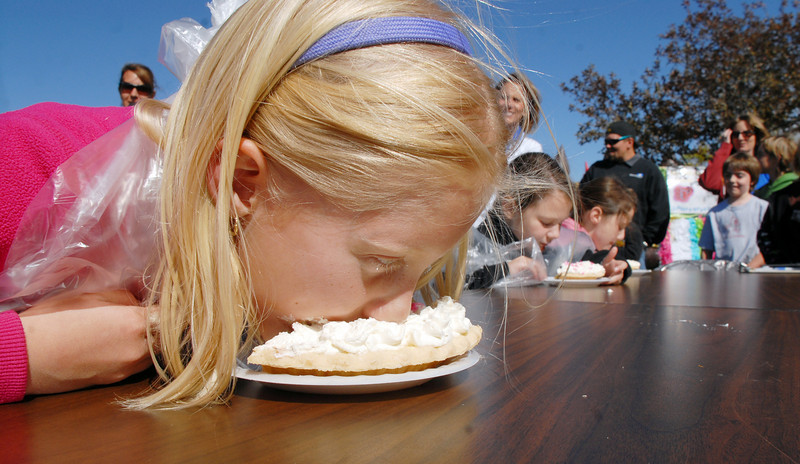 Lilly Marston, 7, won the first round of the pie eating contest during Mtn. View Elementary School's 30th anniversary celebration and fall festival on Saturday.<br /> October 9, 2010<br /> staff photo/David R. Jennings