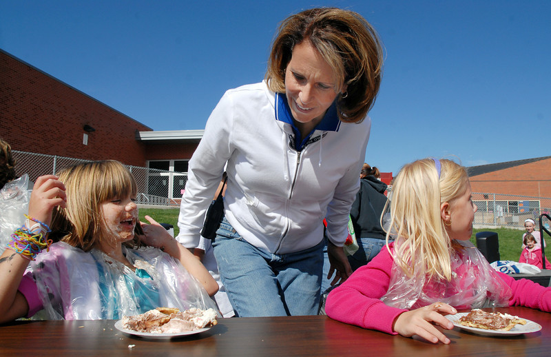 Principal Tracey Amend, center, judges who won the first round of the pie eating contest, Libby Becker,7, left, or Lilly Marston, 7, during Mtn. View Elementary School's 30th anniversary celebration and fall festival on Saturday. <br /> October 9, 2010<br /> staff photo/David R. Jennings