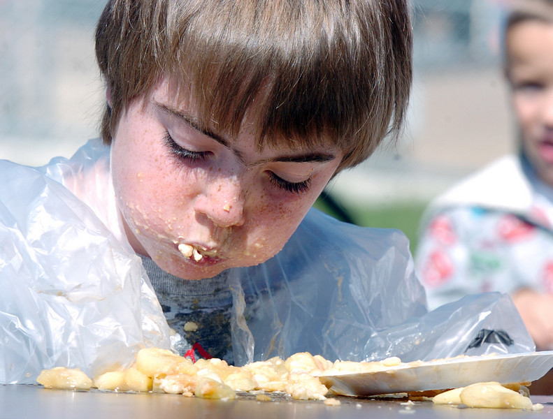 Ryan Hasbrook, 7, consumes an apple pie during the pie eating contest at  Mtn. View Elementary School's 30th anniversary celebration and fall festival on Saturday.<br /> October 9, 2010<br /> staff photo/David R. Jennings
