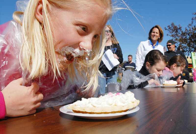 Lilly Marston, 7, competes in the pie eating contest at Mtn. View Elementary School's 30th anniversary celebration and fall festival on Saturday.<br /> October 9, 2010<br /> staff photo/David R. Jennings