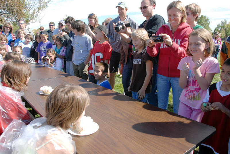 Students and parents watch the pie eating contest during Mtn. View Elementary School's 30th anniversary celebration and fall festival on Saturday.<br /> October 9, 2010<br /> staff photo/David R. Jennings