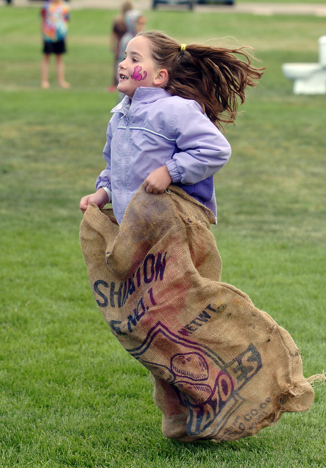 Reagan Petitt, 5, hops in the sack race during Mtn. View Elementary School's 30th anniversary celebration and fall festival on Saturday.<br /> October 9, 2010<br /> staff photo/David R. Jennings
