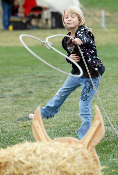 Tara Reid, 8, tests her skill with a lasso during Mtn. View Elementary School's 30th anniversary celebration and fall festival on Saturday.<br /> October 9, 2010<br /> staff photo/David R. Jennings