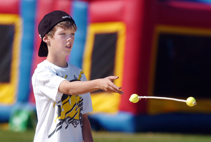 Tommy Ridgsy, 11, tosses a bolo for a game during Mtn. View Elementary School's 30th anniversary celebration and fall festival on Saturday.<br /> October 9, 2010<br /> staff photo/David R. Jennings
