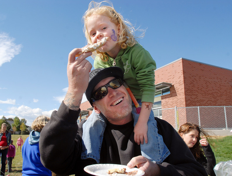 Dennett Marston shares a piece of pie with his daughter Maggie, 3,  during Mtn. View Elementary School's 30th anniversary celebration and fall festival on Saturday.<br /> October 9, 2010<br /> staff photo/David R. Jennings