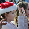 Laurel Sickels, 10, signs with the Mountain View Elementary sign Language choir on Saturday at the Larkridge Retail Center.<br /> November 21, 2009<br /> Staff photo/David R. Jennings