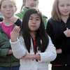 Brenda Boulaphinh, 10, signs with the Mountain View Elementary Sign Language choir on Saturday at the Larkridge Retail Center.<br /> November 21, 2009<br /> Staff photo/David R. Jennings