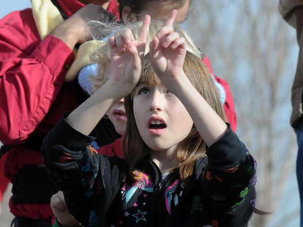 Katrina Tobar, 10, signs with the Mountain View Elementary Sign Language choir on Saturday at the Larkridge Retail Center.<br /> November 21, 2009<br /> Staff photo/David R. Jennings