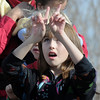 Katrina Tobar, 10, signs with the Mountain View Elementary Sign Language choir on Saturday at the Larkridge Retail Center.<br /> November 21, 2009<br /> Staff photo/David R. Jennings