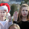 Laurel Sickels,  10, left, and Katelin Pedersen, 10, sign with the Mountain View Elementary sign Language choir on Saturday at the Larkridge Retail Center.<br /> November 21, 2009<br /> Staff photo/David R. Jennings