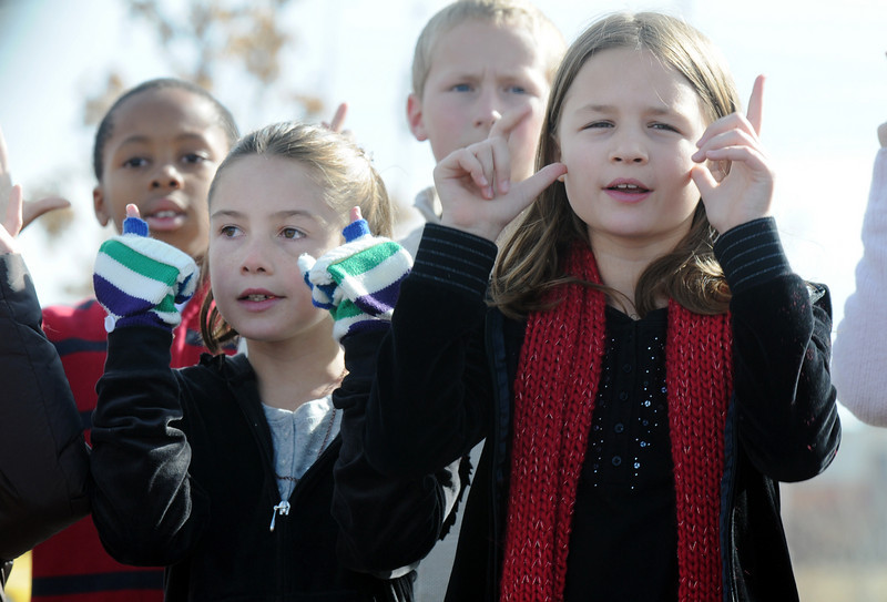 Ashlea Williams, 10, left, and Brittney Calcagno, 10, sign with the Mountain View Elementary Sign Language choir on Saturday at the Larkridge Retail Center.<br /> November 21, 2009<br /> Staff photo/David R. Jennings