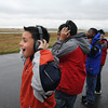 Johny Mendez, 10, left, watches, with classmates from Vaughn Elementary School in Aurora,  the NCAR C130 airplane takeoff  during a break in the tour of the NCAR Gulfstream V aircraft which is being outfitted for the HIPPO II reasearch project at the NCAR base at Rocky Mountain Metro Airport on Wednesay.<br /> <br /> October 21, 2009<br /> Staff photo/David R. Jennings