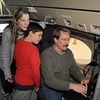 Laura Moin, left, and her son Eitan, 9, from Boulder, watch and talk with NCAR computer scientist Tom Baltzar during a tour of the NCAR Gulfstream V aircraft which is being outfitted for the HIPPO II reasearch project at the NCAR base at Rocky Mountain Metro Airport on Wednesay.<br /> <br /> October 21, 2009<br /> Staff photo/David R. Jennings