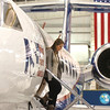 Laura Moin, of Boulder, exits the NCAR Gulfstream V aircraft during a tour of the aircraft which is being outfitted for the HIPPO II reasearch project at the NCAR base at Rocky Mountain Metro Airport on Wednesay.<br /> <br /> October 21, 2009<br /> Staff photo/David R. Jennings